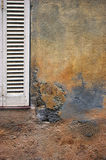 Texture: stone surface with fragment of wooden shutters Stock Photo