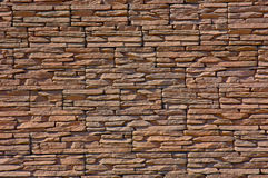 Texture of stone wall. The wall of a thin pink stone Royalty Free Stock Photography