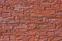 Texture of stone wall. The wall of a thin broken pink stone Royalty Free Stock Photography