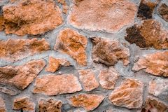 The texture of the stone wall. Background of the old masonry stone with cement royalty free stock photos