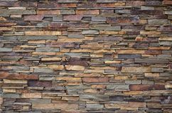Texture of a stone wall from long and rough stones of different sizes and tone. S royalty free stock images