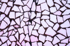 Texture of stone wall with mosaic tiles Stock Photos