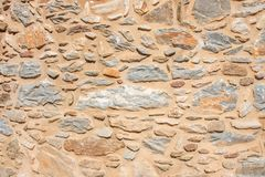 Texture of a stone wall. Old castle stone wall texture background. Briks stone and wall texture. royalty free stock photography