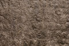 Texture of a stone wall. Old castle stone wall texture background. Stone wall as a background or texture. Part of a stone wall, royalty free stock images