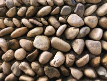 Texture of Stone Wall. Oval Gravel. Texture of Smooth Rubble Wall. Stone Fence stock photography