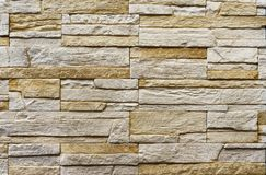 Texture of the stone wall. Panel of stones for finishing the facade of the building and interior design of the house. Background stock image