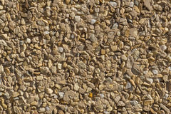 Texture stone wallcovering small pieces different stones Royalty Free Stock Image