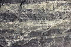 Texture of the stone with white veins. presumably travertine, gneiss or granite.  Royalty Free Stock Photography