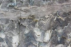 Texture of the stone with white veins. presumably travertine, gneiss or granite.  Royalty Free Stock Images