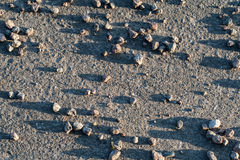 Texture of Stones on Asphalt Stock Photography