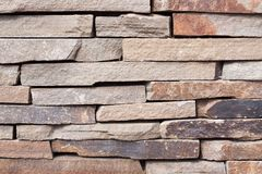 The texture of the stonework gorizontal. The texture of the gray stonework. The wall built of rectangular stones. Space for text. The concept of reliability Stock Photography
