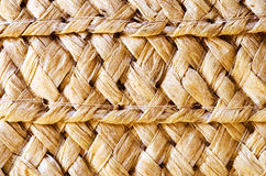 The texture of straw hat. The texture of straw brown hat-brown texture stock photo