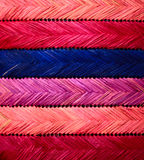 Texture with straw weaving. Color straws in weaving - original texture stock image