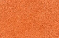 Texture striée rouge de mur de stuc images stock