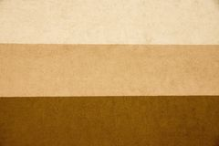 Texture striped plaster of three brown tones Stock Photos