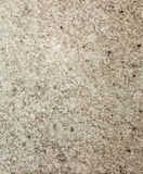 Texture of the structure of the concrete surface floor brown with fractions of small stones close-up Royalty Free Stock Image