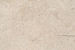 Texture of the structure of the concrete surface with fractions of small stones Stock Photography