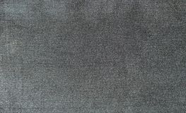 Texture of the surface of denim material. In gray color Royalty Free Stock Photography