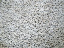 Texture of a surface of granular architectural putty Stock Images
