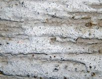 Texture of a surface of granular architectural putty Royalty Free Stock Image