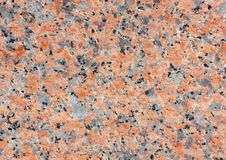 Texture of the surface of natural stone - coral gray granite. Stone pattern, background - photo, image.  royalty free stock photo