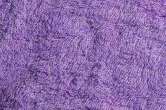 Texture surface of textile, purple cotton fabric. Texture surface of textile, violet cotton towel Royalty Free Stock Image