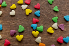 Texture of sweet colorful candy decorations in the form of heart Stock Photos