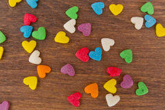 Texture of sweet colorful candy decorations in the form of heart Stock Images