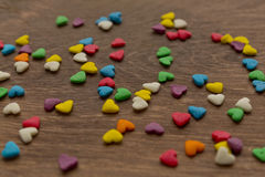 Texture of sweet colorful candy on a heart-shaped Stock Images