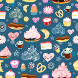 Texture of sweet desserts. Seamless pattern of sweet desserts on a blue background with flowers Royalty Free Stock Photo