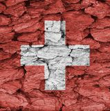 Texture of Switzerland flag. Texture of Switzerland flag on a decorative tree bark Royalty Free Stock Photography
