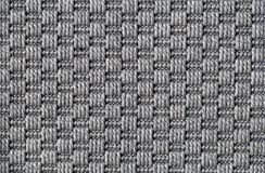 Gray Carpet Texture in a Closeup. Texture of a symmetrical gray carpet. Lovely abstract texture to be used as a background, wallpaper, etc. Semicloseup image royalty free stock images