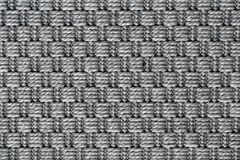 Gray Carpet Texture in a Closeup. Texture of a symmetrical gray carpet. Lovely abstract texture to be used as a background, wallpaper, etc. Semicloseup image stock photos
