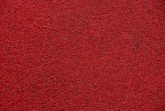 Texture synthétique lumineuse rouge d'éponge de caoutchouc mousse Image libre de droits