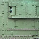 Texture of tank side wall, made of metal and reinforced with a multitude of bolts and rivets. Texture of tank e wall, made of metal and reinforced with a royalty free stock image