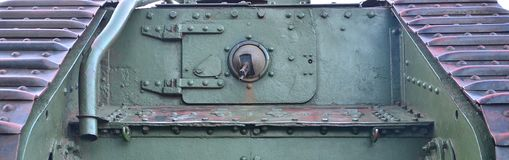 Texture of tank side wall, made of metal and reinforced with a multitude of bolts and rivets. Image of covering of a combat vehicle from the Second World War royalty free stock image