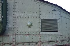 Texture of tank side wall, made of metal and reinforced with a multitude of bolts and rivets. Image of covering of a combat vehicle from the Second World War stock photo