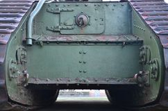 Texture of tank side wall, made of metal and reinforced with a multitude of bolts and rivets. Image of covering of a combat vehicle from the Second World War royalty free stock photos