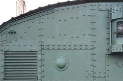 Texture of tank side wall, made of metal and reinforced with a multitude of bolts and rivets. Image of covering of a combat vehicle from the Second World War stock photos
