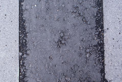 Texture of tarmac road with cracks Stock Image