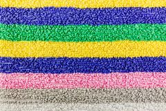 Texture of terry cloth with multi-colored stripes. Natural fabric background Royalty Free Stock Images