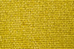 Texture of thick, strong mustard color fabric shot close-up royalty free stock images