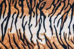 The texture of tiger leather. For background stock photos