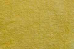 Texture of Towel Fabric. Texture of yellow towel fabric in close up for texture background used Royalty Free Stock Image