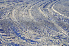 Texture tracks in winter road Royalty Free Stock Photos