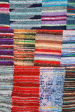 Texture of traditional colorful ethnic rug textile. Stock Photos