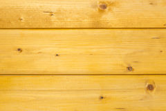 Texture of treated, stained and polished wood with natural spots Royalty Free Stock Image
