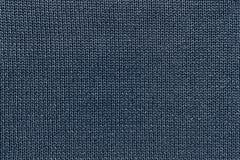 Texture tricotée bleu-foncé de tissu Photographie stock