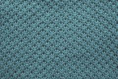 Texture tricotée de nid d'abeilles de couleur verte bleue Images stock