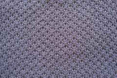 Texture tricotée de nid d'abeilles de couleur violette Images stock
